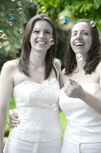 two lesbians at wedding wearing fitted tops