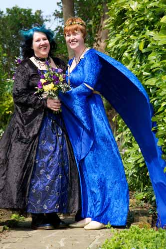 two lesbians at wedding wearing gothic style dresses