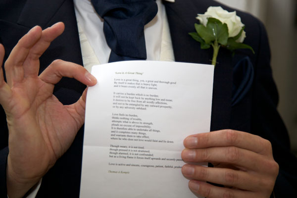 man showing speech paper at wedding