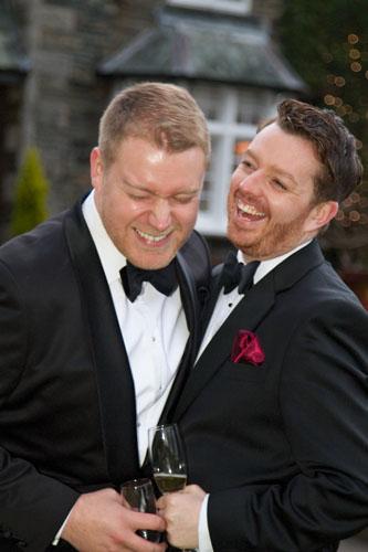 gay men at wedding wearing tuxedo