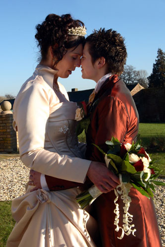 two lesbians at wedding wearing medieval style dresses