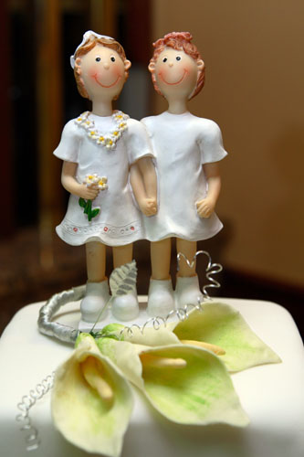 lesbian wedding cake topper to women in white dresses