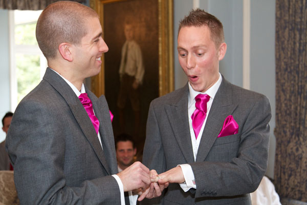 two gay men getting married with ring on finger