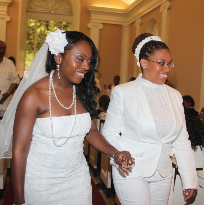 two lesbian brides walking down aisle