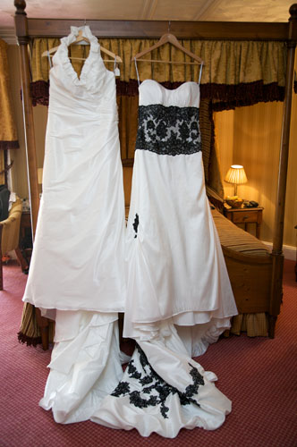 two lesbian wedding dresses hanging up