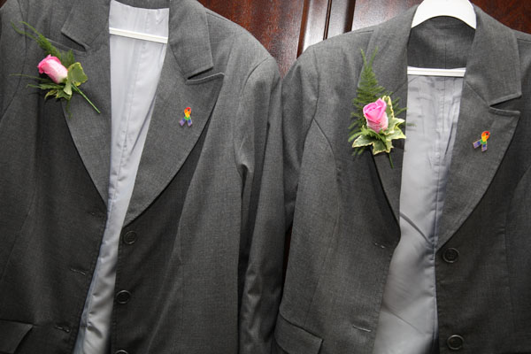 two lesbian wedding suits hanging up