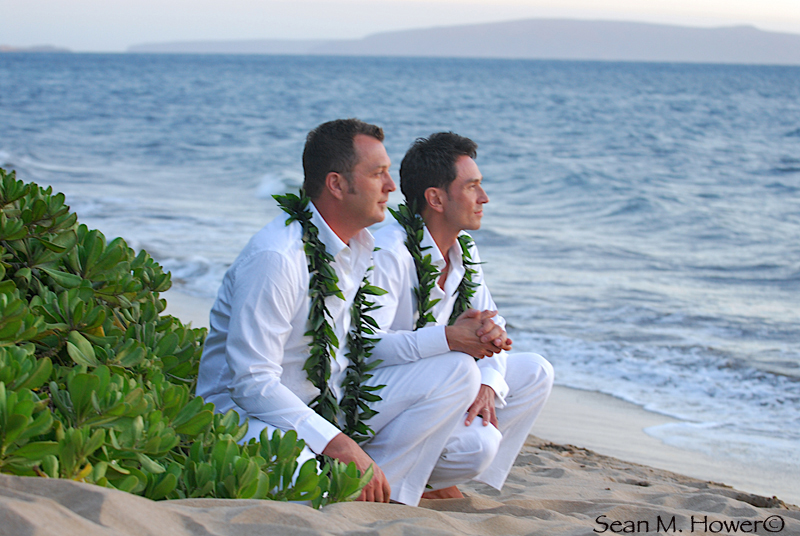 two gay men married on beach