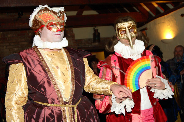 two gay grooms in costume