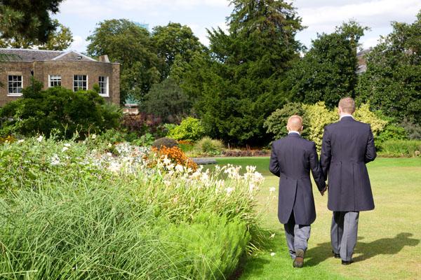 two men wedding grooms holding hands