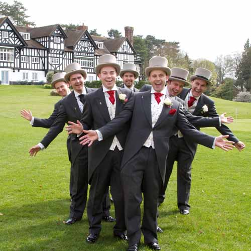 men with top hats at gay wedding