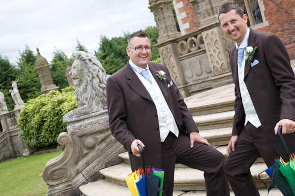 two gay grooms outside historic wedding venue