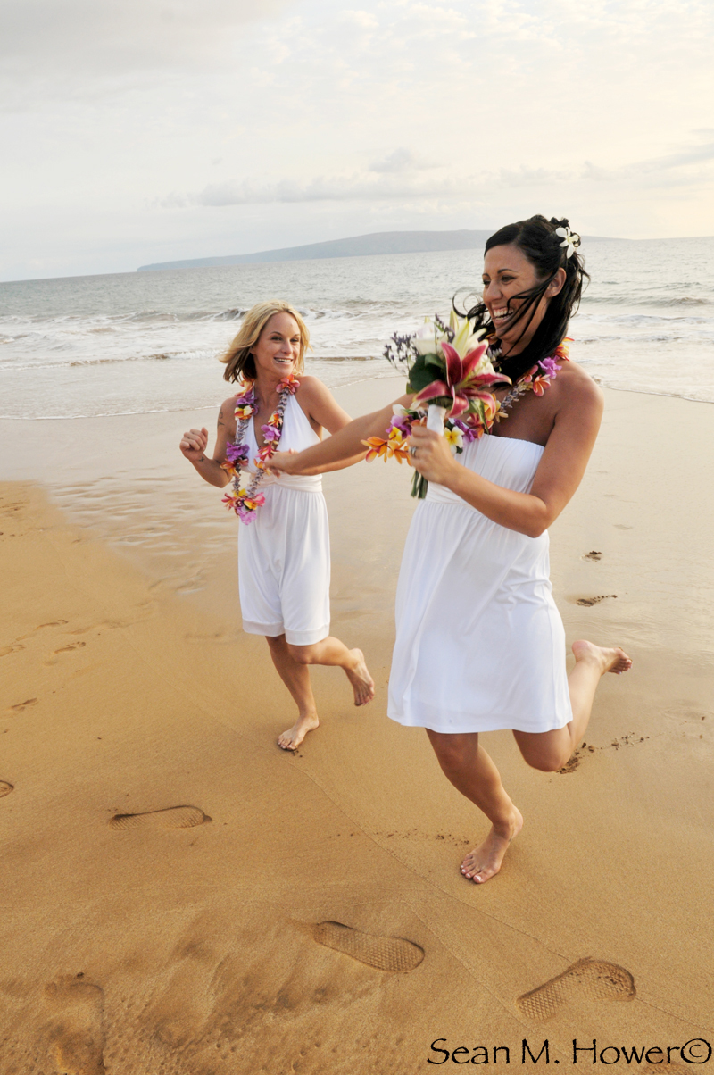 two lesbians just married on tropical beach