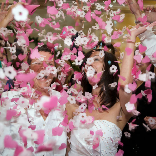 two lesbian brides with confetti