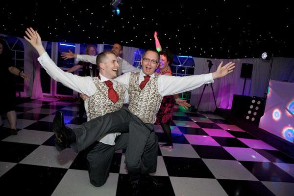two gay grooms dancing on knees