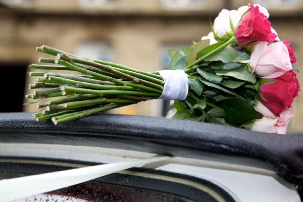 wedding bouquette over car