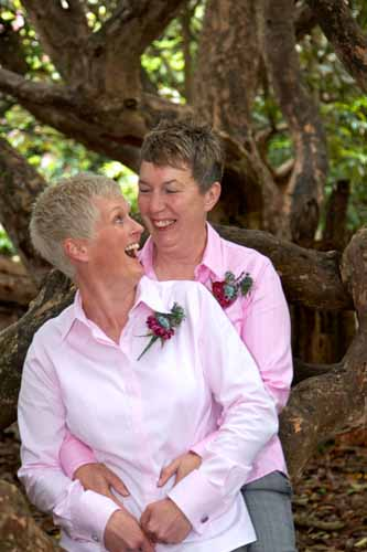 two lesbians at wedding wearing pink shirts