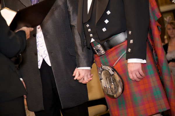 gay men at wedding wearing kilts