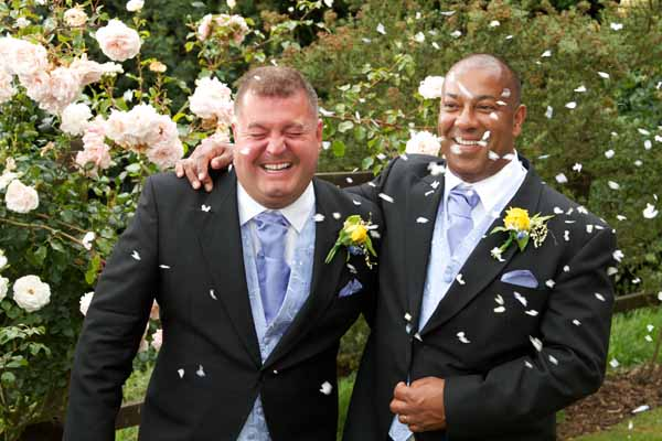 two gay men just married with confetti