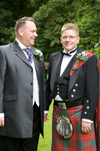 two gay grooms in scottish kilts
